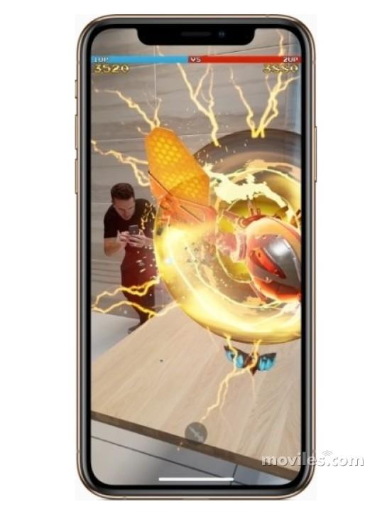 Fotografía grande Varias vistas del Apple iPhone Xs Plata y Gris Espacial y Dorado. En la pantalla se muestra Varias vistas