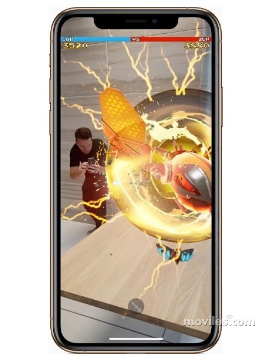 Fotografía grande Varias vistas del Apple iPhone Xs Max Plata y Gris Espacial y Dorado. En la pantalla se muestra Varias vistas