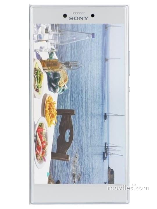 Fotografía grande Varias vistas del Sony Xperia R1 Negro y Plata. En la pantalla se muestra Varias vistas