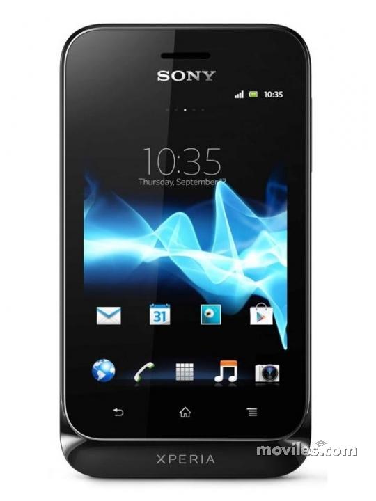 Fotografía grande Frontal del Sony Xperia Tipo Negro. En la pantalla se muestra Reloj